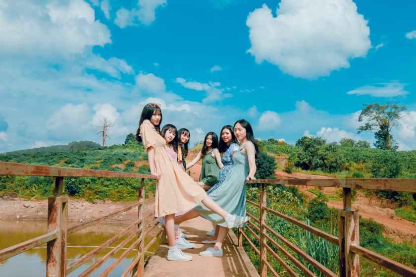 group of women standing on brown bridge