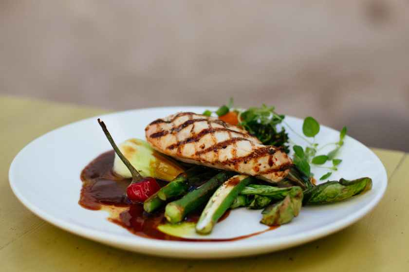 grilled meat with green ladies finger vegetable on white ceramic plate